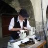 Le banc fustier : Andréas MARTIN en train de tourner une cuillère a miel à la fête du terroir à saint Bonnet le 8 aout 2010